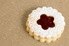 Decorated cookie on baking paper Stock Images