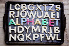 Decorated cookies ALPHABET on baking tray Stock Images