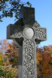 Decorated cross in cemetery during autumn Stock Photo