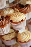 Decorated cup cakes on cake stand Stock Photos