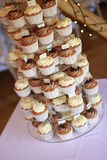 Decorated cup cakes on cake stand Royalty Free Stock Images