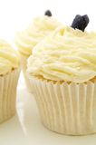 Decorated cup cakes on white Stock Photo