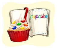 Decorated cupcake and a book Royalty Free Stock Photo