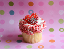 Decorated cupcake on polka dot background Royalty Free Stock Image