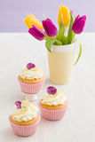 Decorated cupcakes. Cupcakes with buttercream and pansy sugar flowers Royalty Free Stock Photography