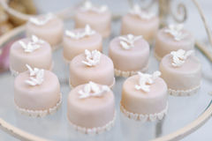 Decorated cupcakes on a glass plate Stock Photography