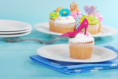 Decorated cupcakes on a plate. With more in background Royalty Free Stock Image