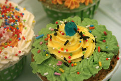 Decorated cupcakes sitting on Royalty Free Stock Photos