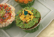 Decorated cupcakes sitting on Stock Photo