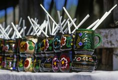 Decorated cups, handcrafts from Zirahuen. Ceramic cups, handcrafts from touristic site of Zirahuen in the state of Michoacan stock photos