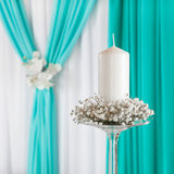 Decorated curtain and candle on candlestick. Stock Image