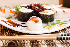 Decorated delicious sushi on table Stock Photo