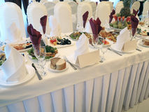 Decorated dining table reception with plates and serviettes Stock Image