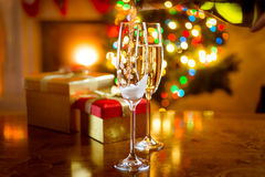 Decorated dinning table for Christmas with glasses of champagne Royalty Free Stock Photos