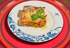 Decorated dish with a traditional homemade lasagna. Royalty Free Stock Images