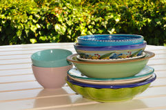 Decorated dishes and bowls on a garden table Stock Image