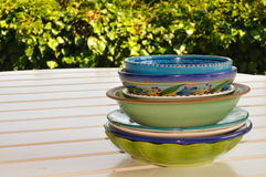 Decorated dishes on a garden table Stock Image