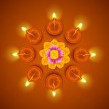 Decorated Diwali Diya on Flower Rangoli Stock Photography