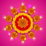 Decorated Diwali Diya on Flower Rangoli Stock Photos