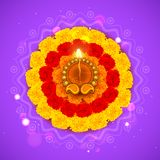 Decorated Diwali Diya on Flower Rangoli Stock Photos
