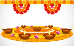 Decorated Diwali Diya on Flower Rangoli Stock Photography