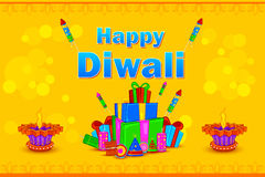 Decorated diya with gift for Happy Diwali holiday background Stock Images