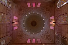 Decorated dome mediating ornate ceiling with floral pattern decorations at Khayer Bek Mausoleum, Cairo, Egypt. Decorated dome mediating ornate ceiling with stock image