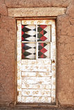 Decorated Door and Adobe Building. Taos Pueblo Royalty Free Stock Image