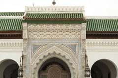 Entrance of a mosque in Fes, Morocco. Decorated door and green roof - entrance to a mosque in Fes Morocco stock images