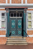 Decorated door of a historical house in Stade Royalty Free Stock Photos