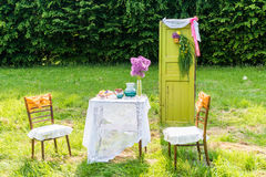 Decorated door table chairs. Decorated door, table, chairs in the garden royalty free stock images