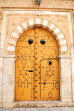 Decorated door in Tunis medina. Decorated orange door in Tunis old city Royalty Free Stock Photos