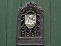 Decorated door viewer with bas-relief of virgin mary with baby jesus Royalty Free Stock Photos