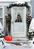Decorated doorway. Home entrance decorated for holidays Stock Photo