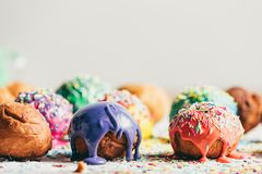 Decorated doughnuts on a kitchen counter. Couple of decorated glazed doughnuts laying next to each other on a kitchen counter Stock Photos