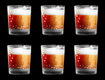 Decorated drinking glasses for New Year Eve. A set of six decorated alcohol drinking glasses for New Year's Eve for the years 2010, 2011, 2012, 2013, 2014 and Royalty Free Stock Images