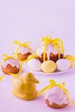 Decorated easter cakes and eggs  in yellow colors. Selective focus Royalty Free Stock Images