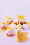 Decorated easter cakes and eggs  in yellow colors. Selective focus Stock Photos