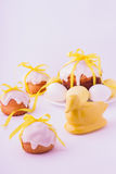 Decorated easter cakes and eggs  in yellow colors. Selective focus Stock Image