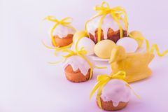 Decorated easter cakes and eggs  in yellow colors. Selective focus Stock Images