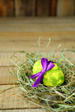 Decorated Easter egg on wooden board Stock Photo