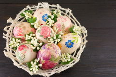 Decorated Easter eggs in a basket Stock Photos