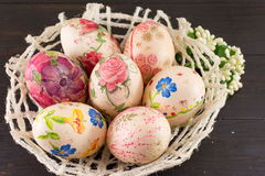 Decorated Easter eggs in a basket Royalty Free Stock Photos