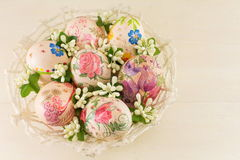 Decorated Easter eggs in a basket royalty free stock image