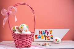Decorated Easter eggs in a basket stock photography