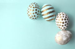 Decorated Easter eggs in a bowl, closeup on pastel background. Cup of tea royalty free stock photography