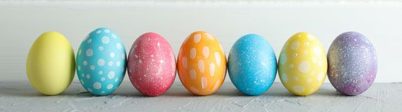 Decorated Easter eggs on color background, closeup stock photo
