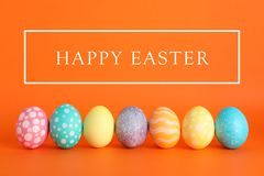 Decorated Easter eggs on color background stock images