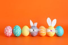 Decorated Easter eggs and cute bunny`s ears on background stock photos