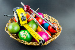 Decorated Easter eggs in a engineer woven basket Royalty Free Stock Photos